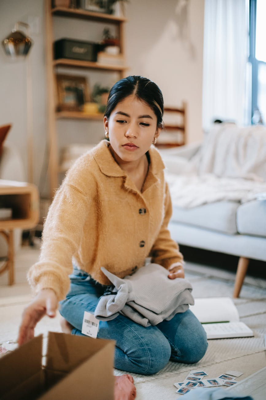 woman decluttering to reduce stress and anxiety