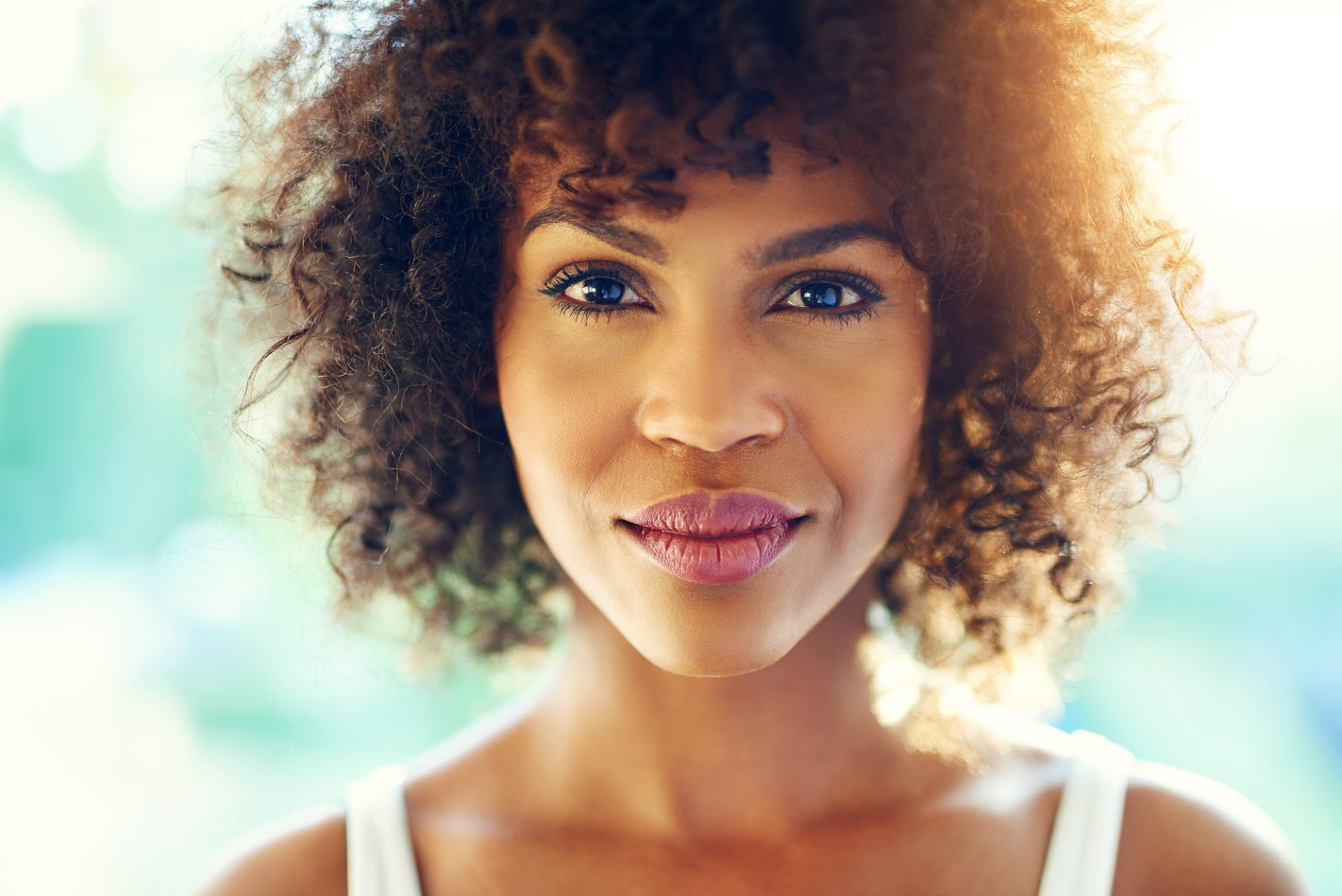 Beautiful black woman with curly hair